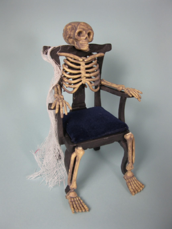 skeleton chair with blue velvet cushion the dabbler