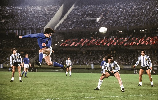 Paolo Rossi, the Italy striker, sends a spectacular header towards goal during the 1‒0 win over Argentina, which meant his team finished above the hosts at the top of their first-round group.