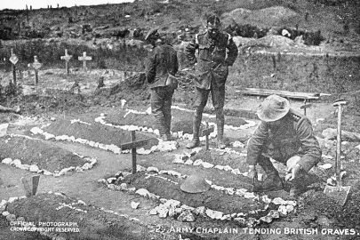Army Chaplain tending British graves.